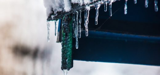 Icicles on a house roof. Photograph by Aureliy Movila