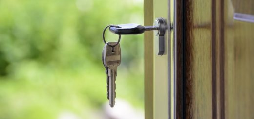 Keys in a front door. Photograph by WDnet Studio