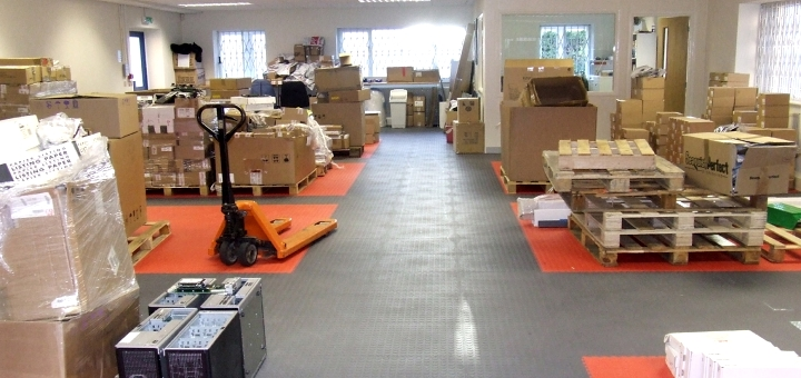 Alternative warehouse floor using interlocking PVC tiles from R-Tek