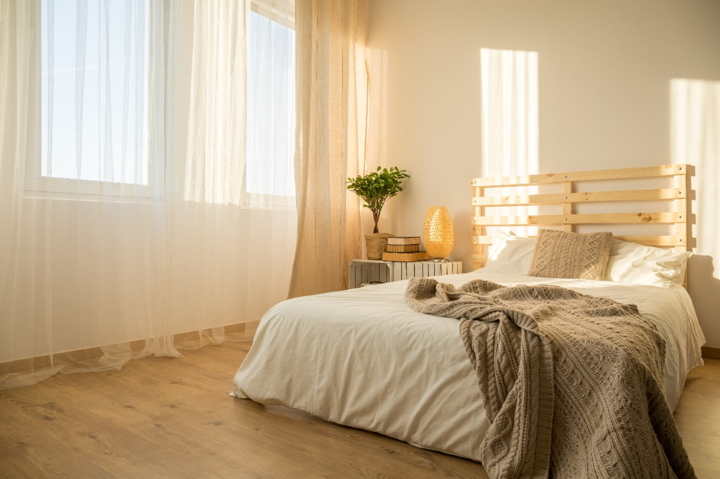 Generous windows dressed with lightweight curtains can create a bright and relaxing feel