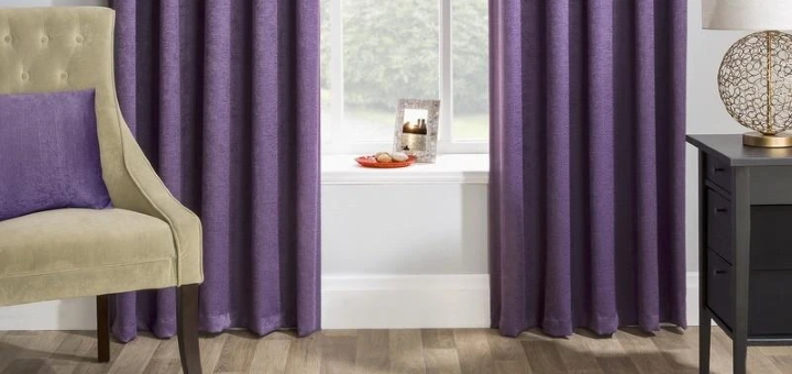 Bedroom curtains like these from Terrys Fabrics can provide both privacy and a splash of warm colour